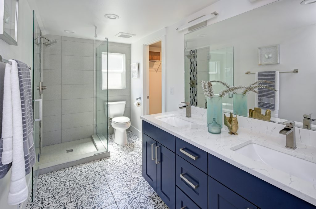 Blue painted bathroom cabinets