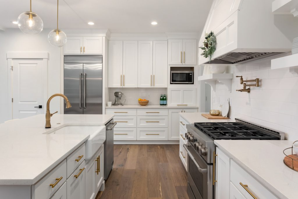 Modern, white cabinet kitchen with stainless steel appliances